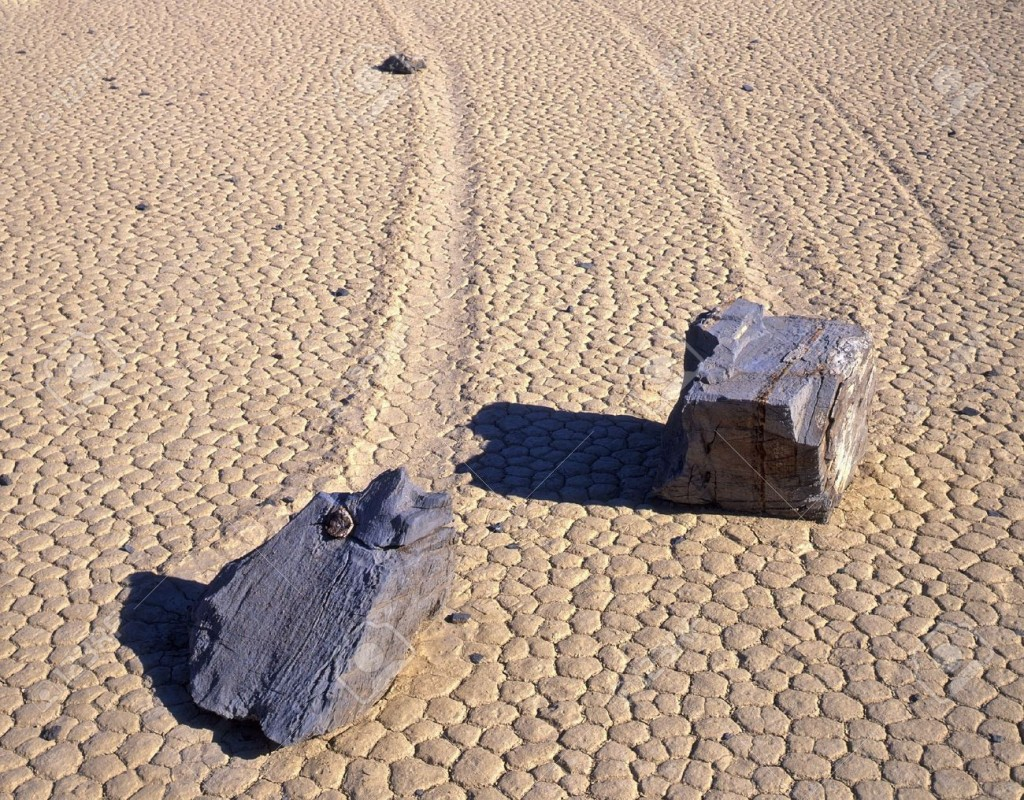 760733-Two-rocks-and-theie-trails-on-the-Racetrack-Playa-in-Death-Valley-National-Park-California--Stock-Photo