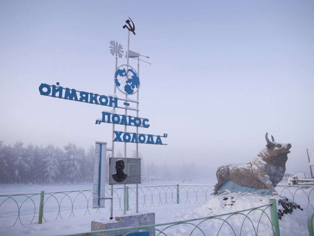 "The communist-era monument marking the record-breaking temperature of -71.2 recorded in the village in 1924. The reads ""Oymyakon, the Pole of Cold."" Journey to Oymyakon, the coldest permanently inhabited settlement in the world. The village was originally a stopover for reindeer herders who would water their flocks from a thermal spring. Known as the ""Pole of Cold"" the town of 500 once recorded a temperature of -71.2. Average temperatures in January are -50c. PHOTO BY AMOS CHAPPLE / REX FEATURES **NORTH/SOUTH AMERICA OUT**"